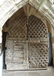 800px-Latticework_door,_Chepstow_castle